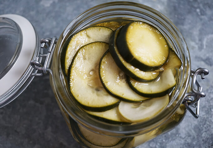 An overhead shot of a glass jar filled with easy refrigerator pickles.