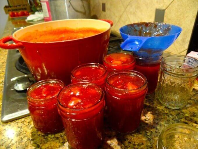 ladle jam into jars