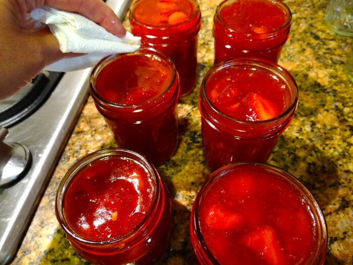 cleaning tops of the jars