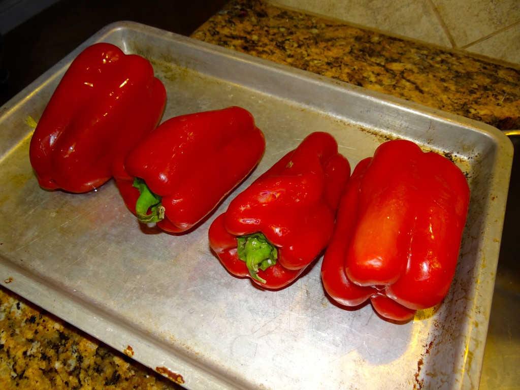Prepping the peppers for broiling.