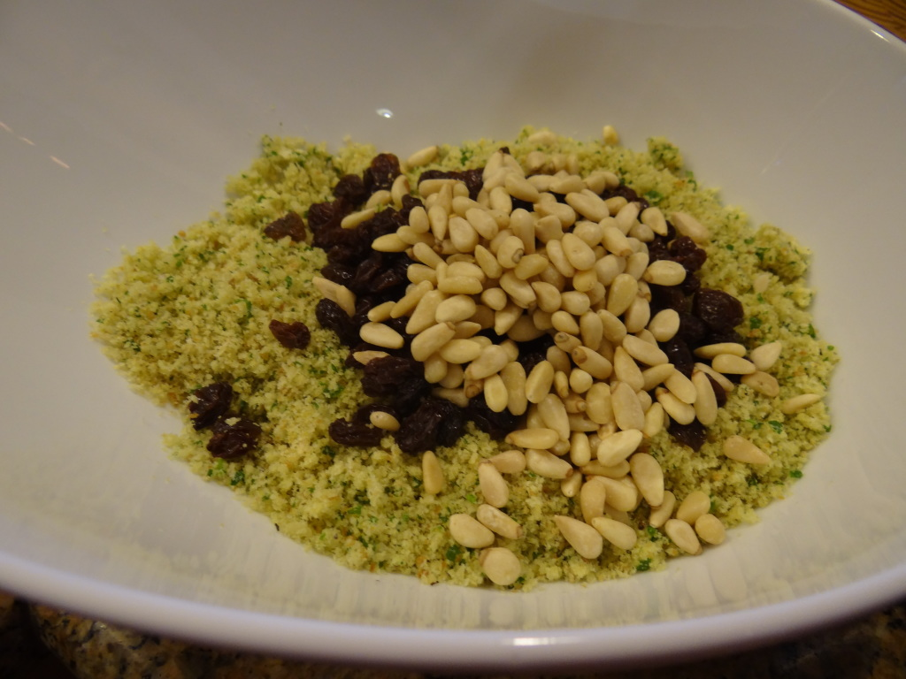 Breadcrumbs, pine nuts, raisins and parmesan cheese.