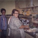 Grandma and Mom cooking dinner.
