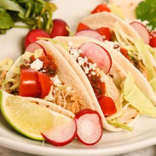 Slow Cooker Shredded Chicken Tacos on a white platter.