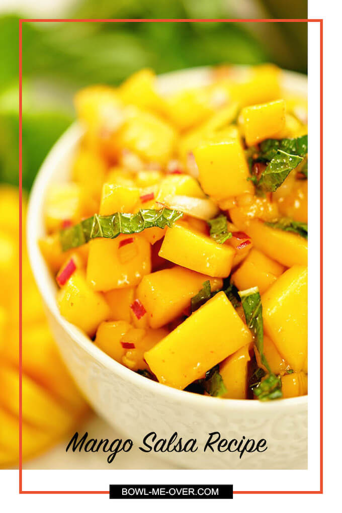 A white bowl filled with mango salsa, this is an easy mango salsa recipe