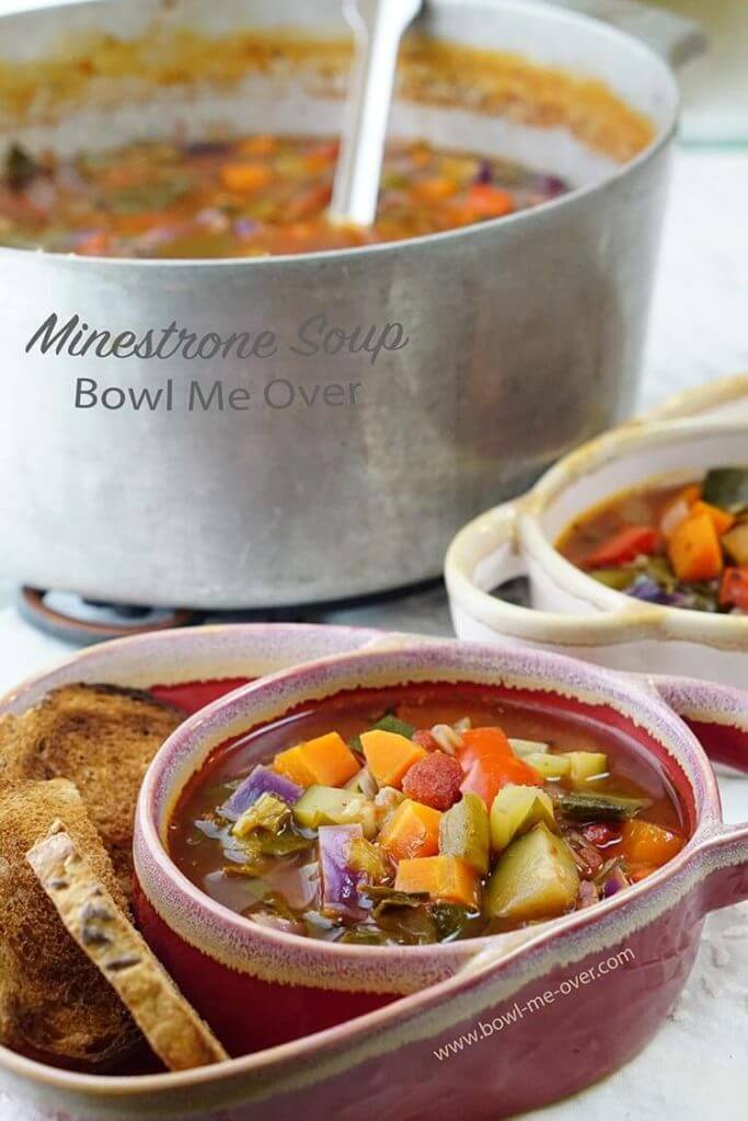 Homemade Minestrone Soup in bowls with soup pot.