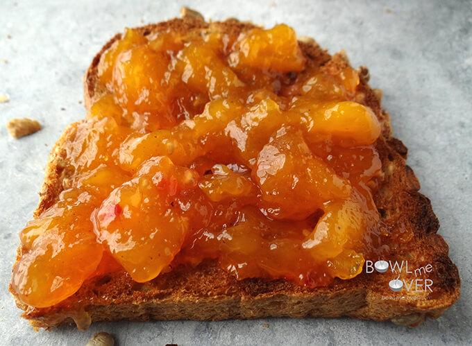 A slice of toasted bread spread with homemade mango jam.