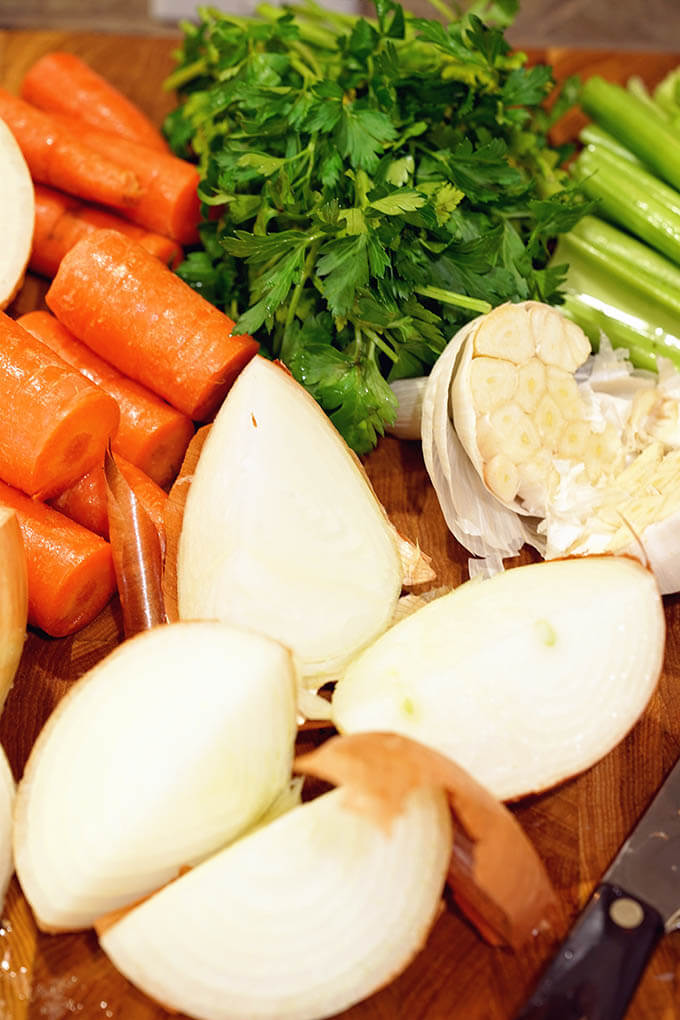 Photo of beef stock Ingredients; onions, garlic, celery, carrots and parsley