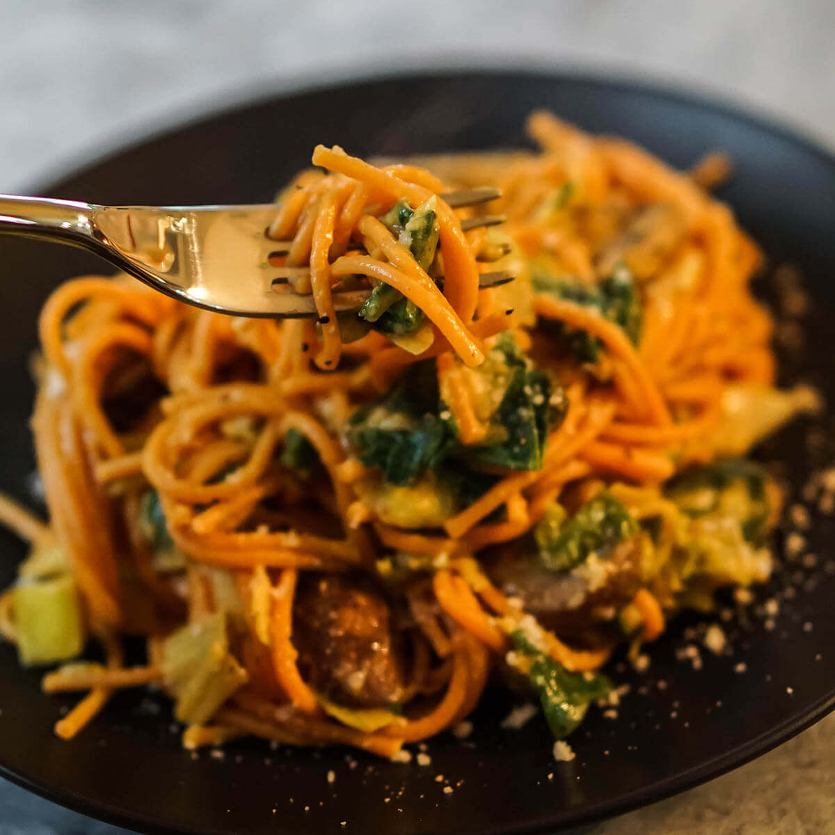 Butternut squash pasta on plate with fork.