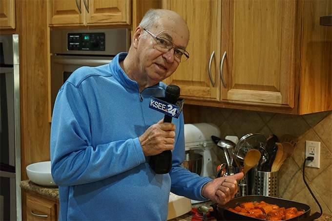 Dad with a microphone on tv talking about candied sweet potatoes.