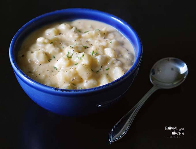 A blue bowl filled with Easy Potato Soup.