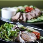 Pork Tenderloin Salad on greens with creamy dressing.