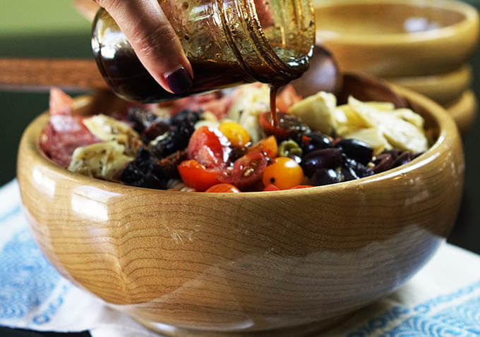 Just pour on your dressing - it's quick, easy, light & perfect for this yummy Antipasto Pasta Salad!