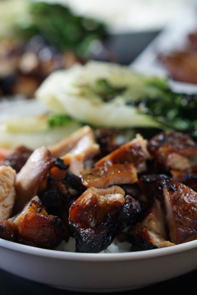 A teriyaki chicken bowl filled with tender chicken, white rice and bok choy.