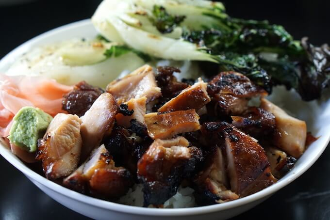 Chicken Teriyaki Bowl using grilled chicken thighs piled over white rice with bok choy and pickled ginger.