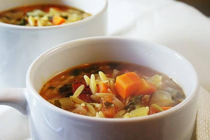 Vegetable Orzo Soup in white bowls.