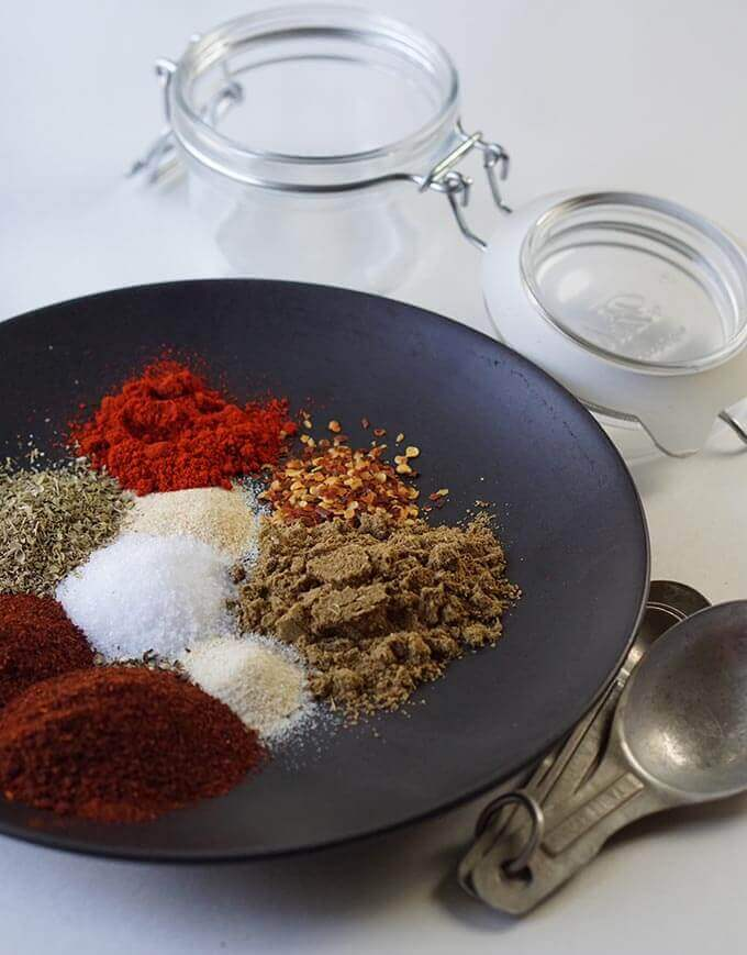 Spice ingredients for Taco Seasoning on black plate