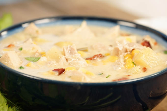 A blue bowl filled with turkey chowder