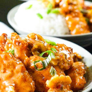 White bowls full of sweet Panda Express honey walnut shrimp Recipe, topping off mounds of white rice.