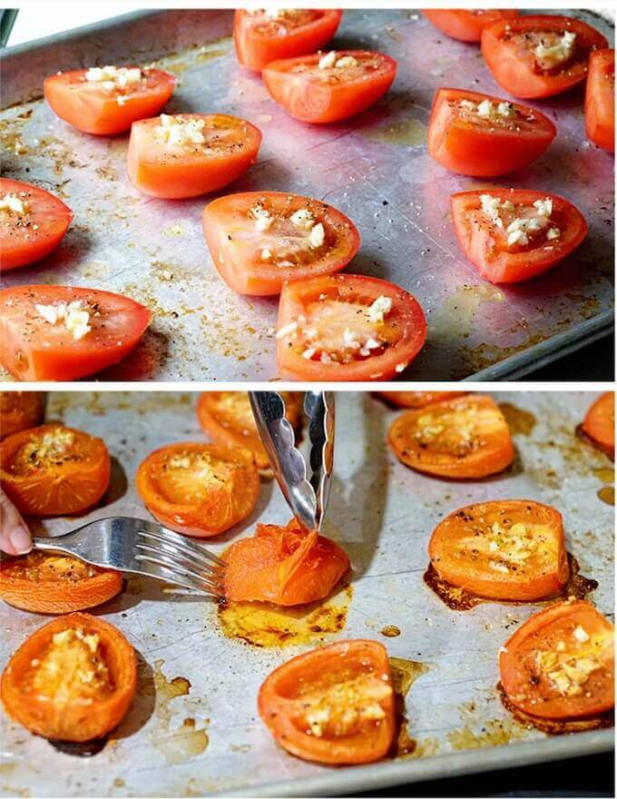 A cookie sheet filled with tomatoes. This shows Step-by-step directions to roast tomatoes and remove the skins, for preparation to make this soup.