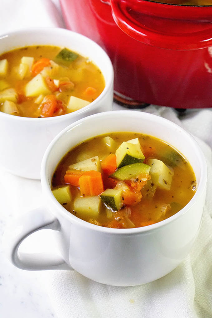 Vegetable Soup in white bowls.