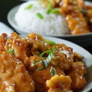 White bowls full of delicious honey shrimp, topping off mounds of white rice. My Honey Walnut Shrimp Recipe is quick and easy to make.