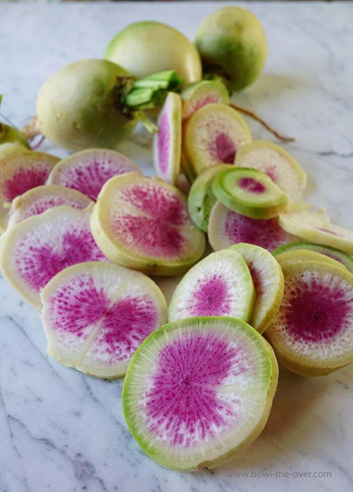 These are watermelon radishes also known as Chinese radishes.
