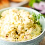 A green bowl filled with egg salad recipe