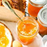 Apricot jam on a slice of bread.