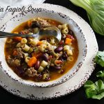 A steaming bowl of pasta Fagioli Soup filled with big meaty flavors and full of delicious vegetables.