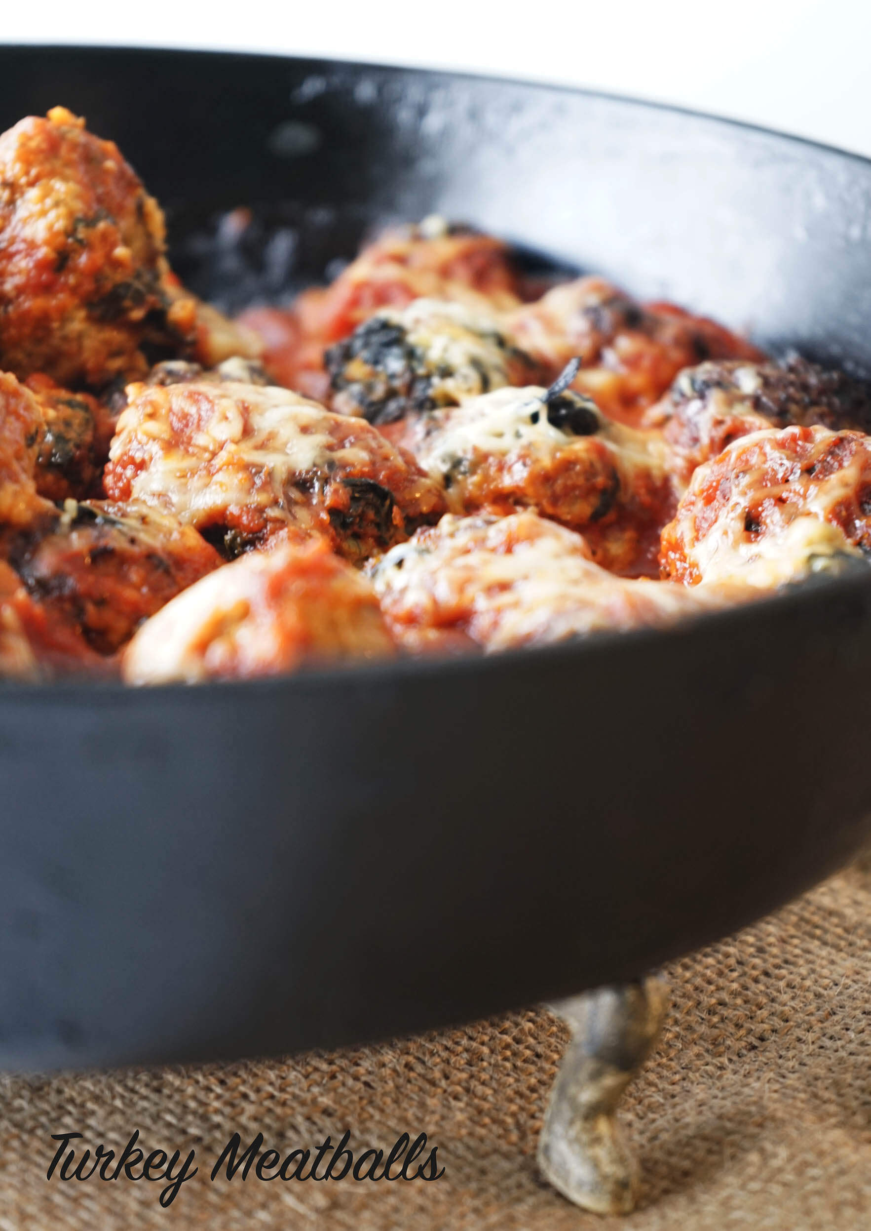 Easy Turkey Meatball Recipe in skillet topped with cheese.