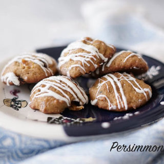 Persimmon Cookies on plate drizzled with white choclate