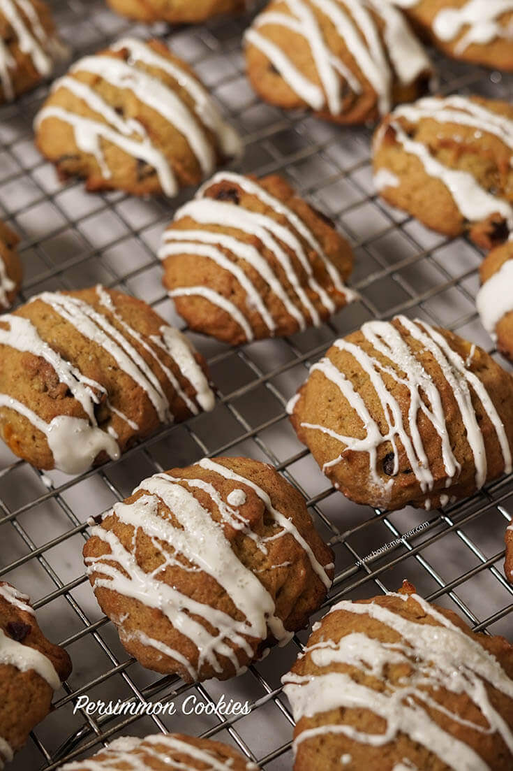 Persimmon Cookies Recipe drizzled with white chocolate on a cooling rack.