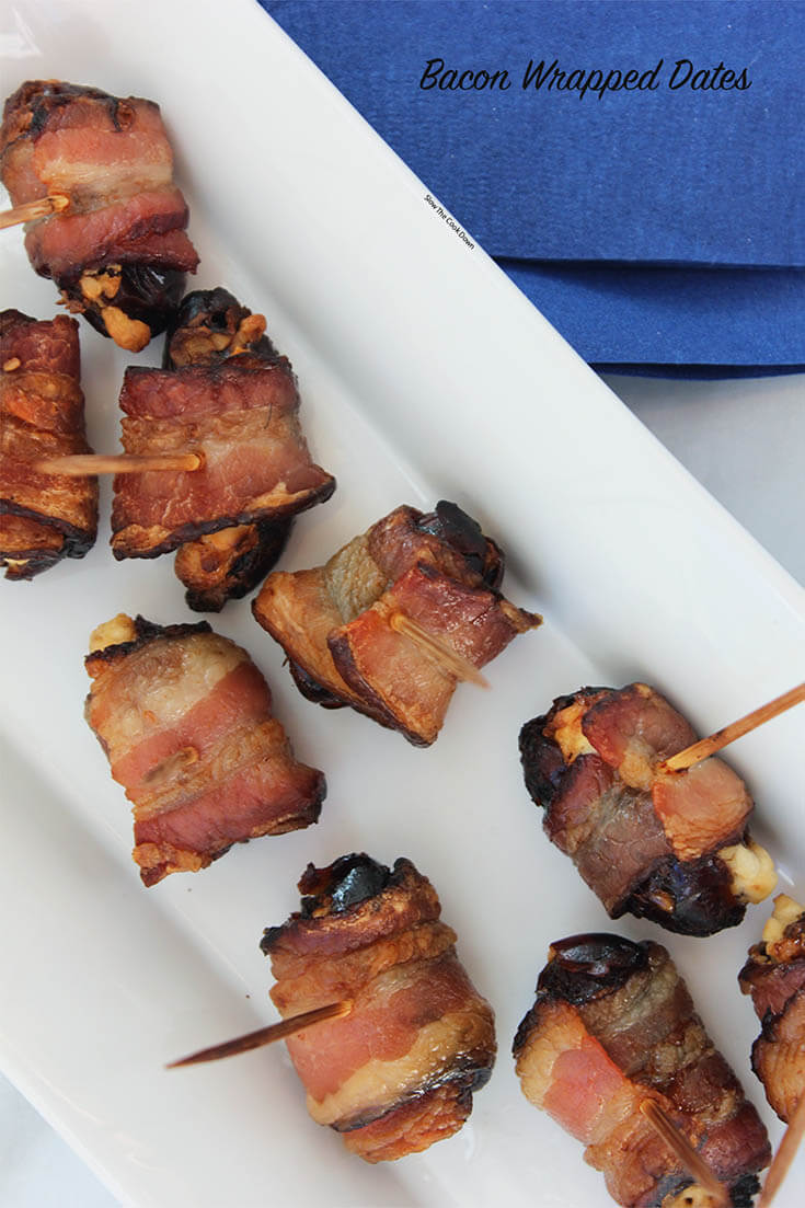 Bacon Wrapped Dates Goat Cheese skewered by toothpicks.