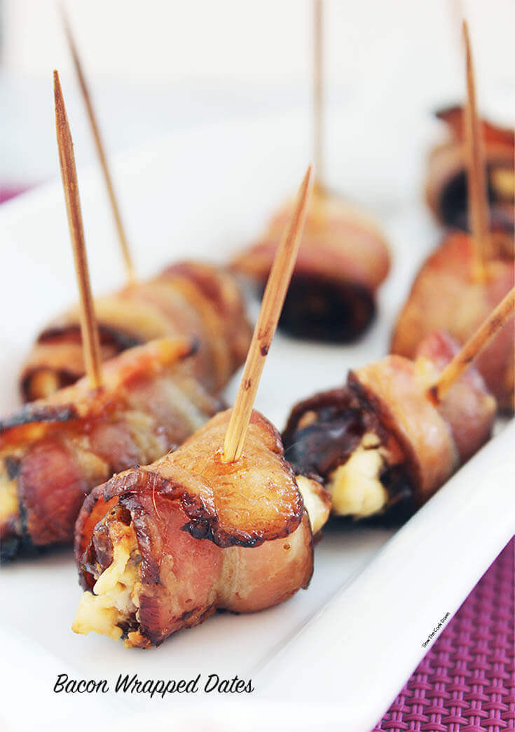 Bacon Wrapped Dates - Salty bacon wrapped around sweet dates, stuffed with creamy goat cheese! #BaconWrappedDates #EasyAppetizer #PartyFood #BowlMeOver