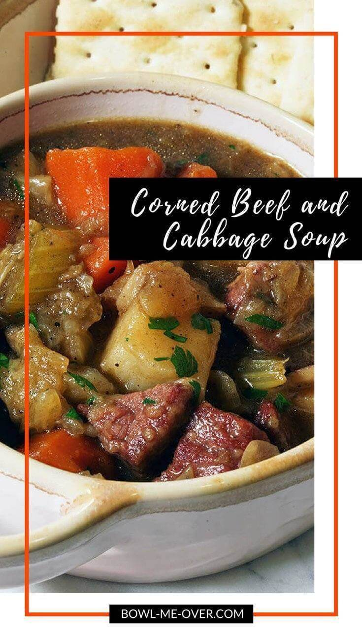 A hearty bowl of corned beef and cabbage stew with big hunks of meat and chunks of soft tender vegetables.