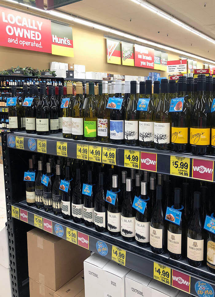 A photo of the wine aisle at Grocery Outlet showing bottles and bottles of chardonnay.