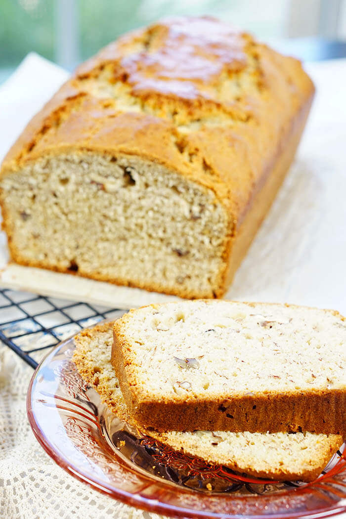Slices of banana nut bread with the golden delicious loaf nearby, ready to slice off another piece to enjoy! Moist Banana Nut Bread Recipe