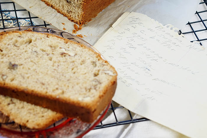 Slices of banana bread alongside Grandma Few's Moist Banana Nut Bread Recipe