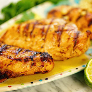 Heat up the grill, you're going to love this chili lime chicken! Here's a platter of cooked chicken and who's hungry?