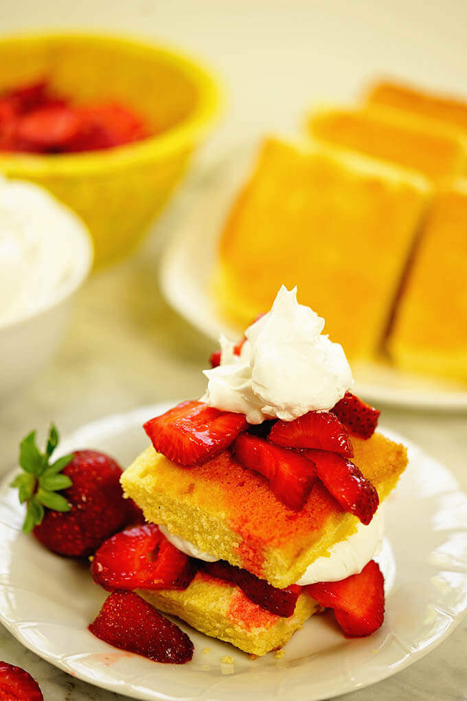 Easy strawberry shortcake recipe with extra servings of cornbread, cream and strawberries