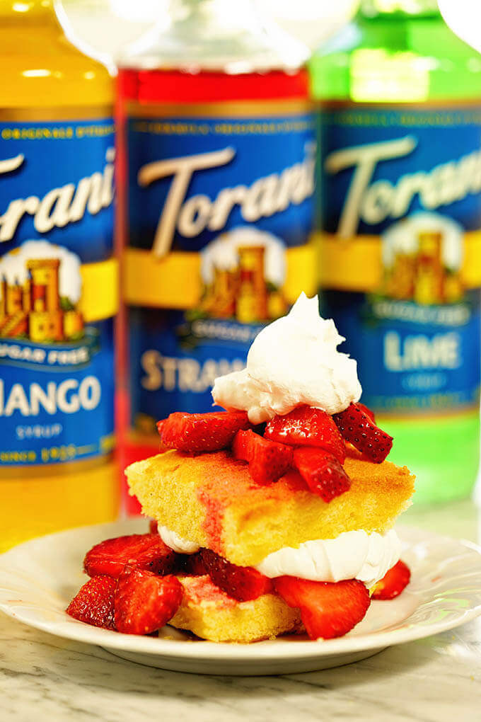 Strawberry Shortcake Recipe surrounded by bottles of Torani