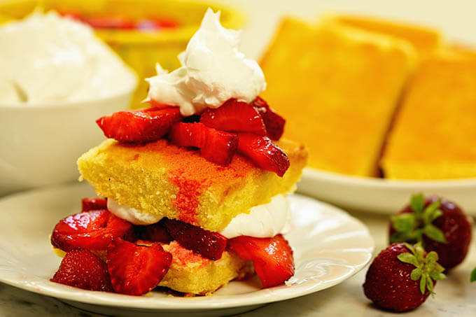 Easy strawberry shortcake piled high and topped with whipped cream