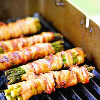 How to grill asparagus - Asparagus wrapped in bacon being cooked on the grill.