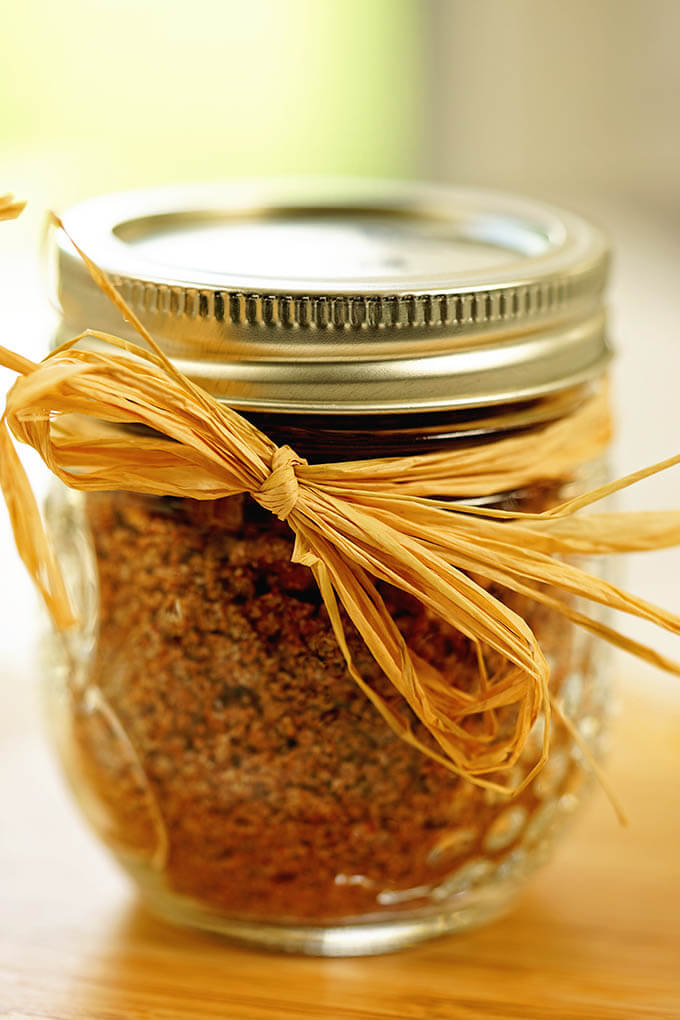 A jar of sweet rib rub packaged with a bow, ready to give for a gift.