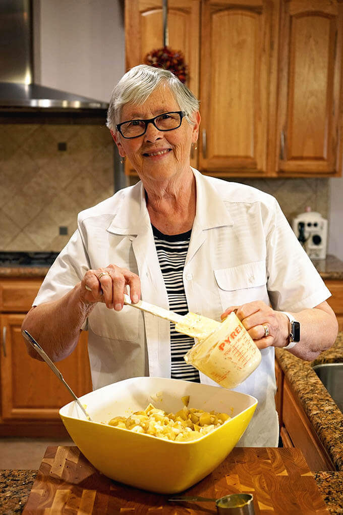 Mom making Deviled Egg Potato Salad
