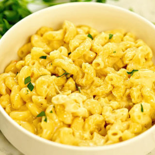 A white bowl filled with Instant Pot Macaroni and Cheese