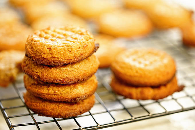 Stacks of peanut butter cookies on a cooling rack