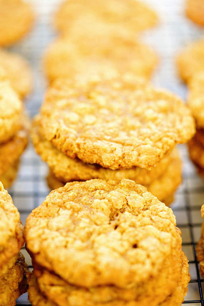 Stacks of easy oatmeal peanut butter cookies on a wire cooling rack.