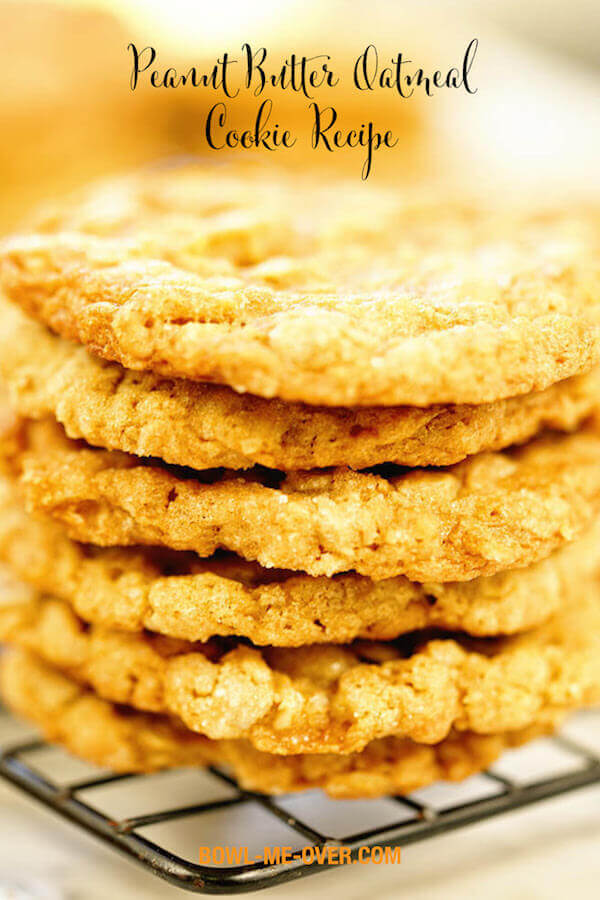 A stack of six oatmeal peanut butter cookies on a cooling rack.