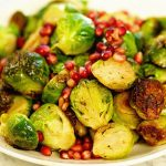sautéed Brussel sprouts topped with pomegranate arils